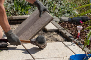 Picture of a technician installing patio pavers.